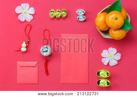 Above view shot of accessories Chinese new year & Lunar festival concept background.Flat lay of arrangement essential items on modern rustic wood red wallpaper.Sign objects for the decor season.