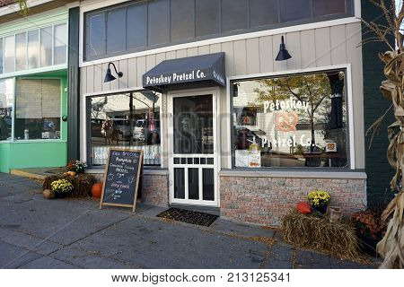 PETOSKEY, MICHIGAN / UNITED STATES - OCTOBER 18, 2017: One may eat freshly baked pretzels and drink apple cider at the Petoskey Pretzel Company, in downtown Petoskey.
