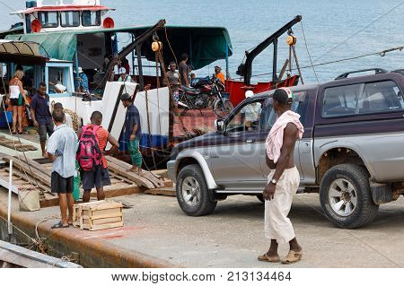 Malagasy Peoples Loading Ship In Nosy Be, Madagascar