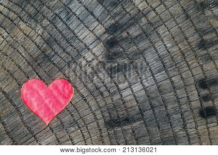 Heart shape made from paper placed on wooden background love concept