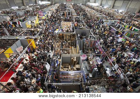 ROME, ITALY. October 4, 2015: Crowd thousands people aerial view. Packed crowded fair. Romics 2015.  Thousands of people flock to the exhibition of comics, cartoons and movies.