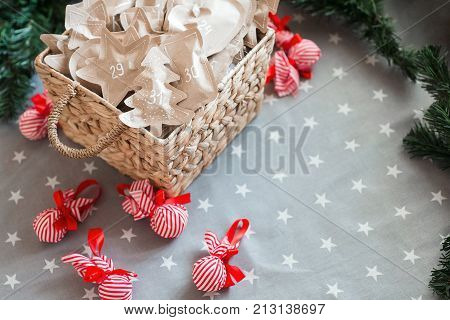 Christmas kraft paper wrapping presents with fir branches. Christmas background with decorated gift boxes. Copy space. Advent calendar until December 31.