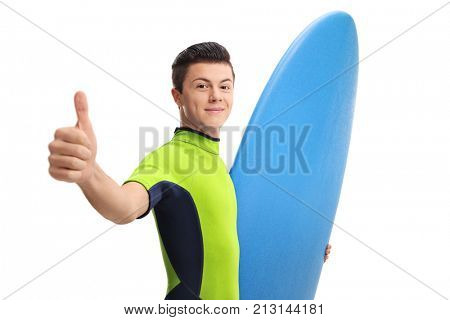Teen surfer making a thumb up sign isolated on white background