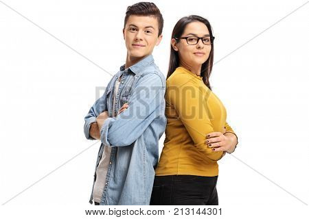 Teenage boy and a teenage girl with their backs against each other looking at the camera isolated on white background