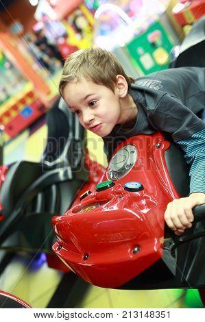 Child Playing In Bike Simulator