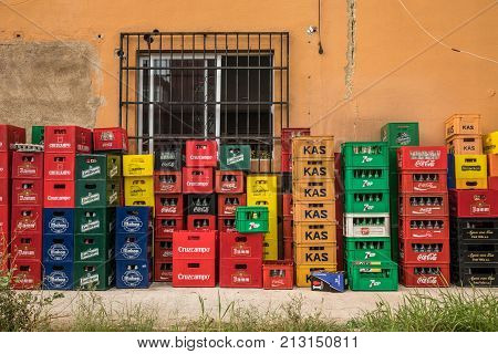 SANTA PONSA, BALEARIC ISLANDS/SPAIN - OCTOBER 2 2017: Crates of empty drinks at the back of a bar