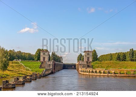 River landdscape with gateway on Moscow Canal. Russia