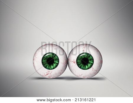 Two green eyes on grey background. image of concept