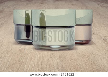Cosmetic jars of clay on wooden background. Three jars closed. 3D illustration