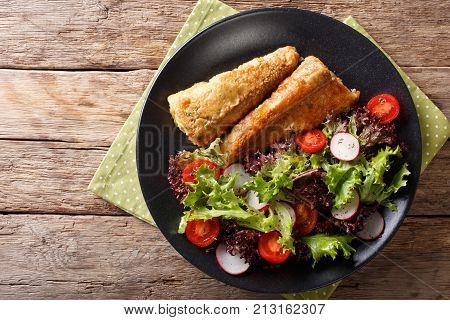 Fried In A Battered Hake And Fresh Salad Close-up. Horizontal Top View