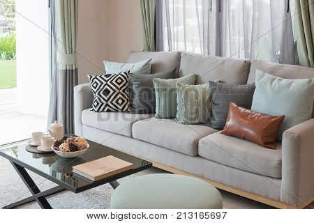 Modern Living Room With Set Of Sofa And Pillows