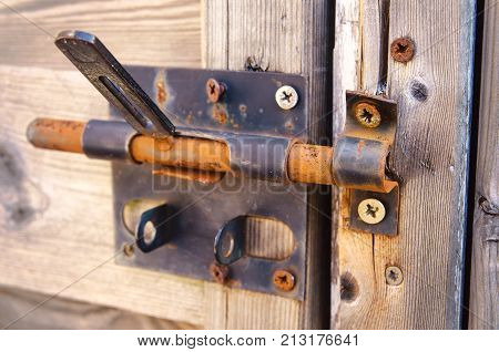 an old door lock with rusty latch