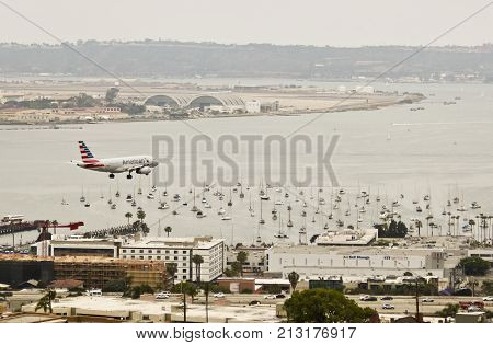 SAN DIEGO, CALIFORNIA, JUNE 7. Downtown on June 7, 2017, in San Diego, California. An American Jet on Approach Over Downtown San Diego California.