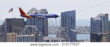 SAN DIEGO, CALIFORNIA, JUNE 9. Downtown on June 9, 2017, in San Diego, California. A Southwest Boeing 737 Flaps and Landing Gear Down on Approach in San Diego in California.