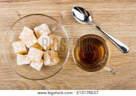 Rakhat-lukum In Transparent Saucer, Cup Of Tea And Teaspoon