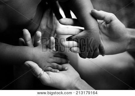 Black children's hands hold white hands of adult. Friendship Adoption and care. Joy of parenting. Trust and family. Happy childhood. African child. Hope for future father mother and son or daughter