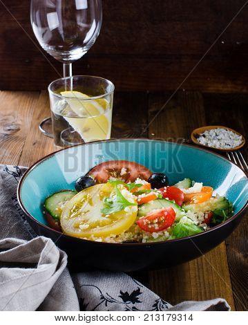 Tabbouleh Salad On Dark Wooden Background