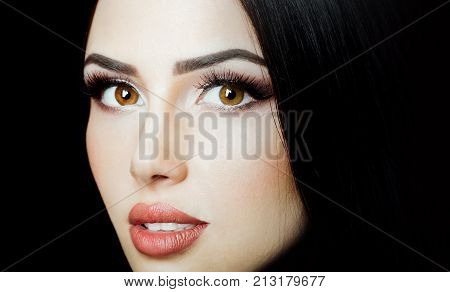Beauty Woman face Portrait. Beautiful Girl with Perfect Fresh Clean Skin. Portrait of beautiful young woman with long black hair. Closeup face of pretty caucasian model looking at camera