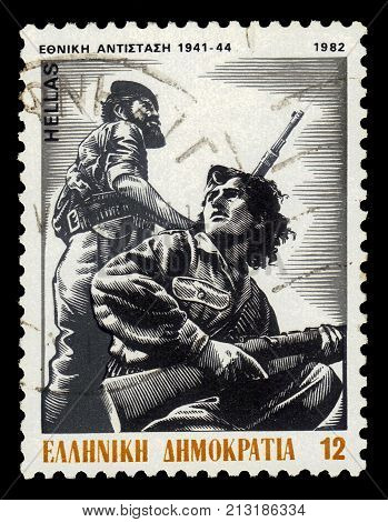 GREECE - CIRCA 1982: stamp printed by Greece shows resistance fighters by P. Gravalos, dedicated to the National Resistance Movement in Greece, 1941 - 1944, circa 1982