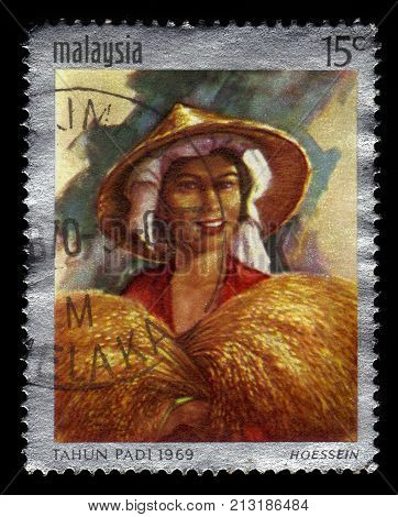 MALAYSIA - CIRCA 1969: A stamp printed in Malaysia shows Tahun Padi artwork by malaysian artist Hoessein Enas, international rice year, circa 1969