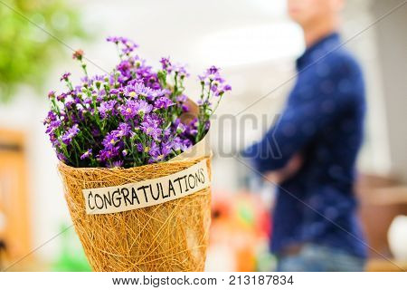 Beautiful violet or purple Gypsophila flower in brown grid paper bouquet for you with