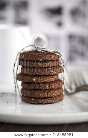chocolat cookies home made gift with morning coffee close up photo with blur background
