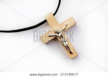 wooden cross with jesus on white background