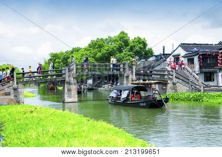 August 8 2015. Xitang Town China. Tourist boats on the water canals of Xitang old town located in in Jiashan County in Jiaxing City Zhejiang Province china.