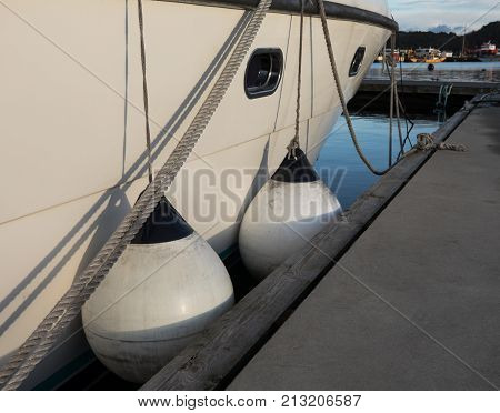 Boat fenders between berth and motor boat, protecting the ship