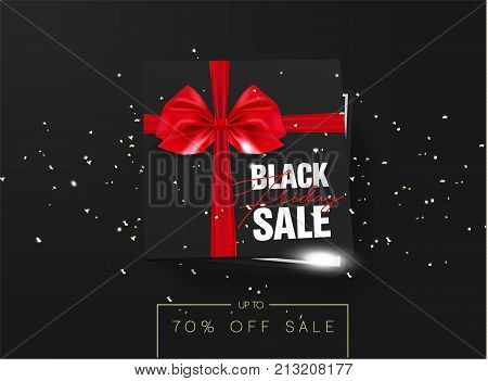 Black friday sale Black cardboard box tied with a red ribbon bow is lying on a black background with confetti and inscription Black friday Top view Template for the poster, banner and web
