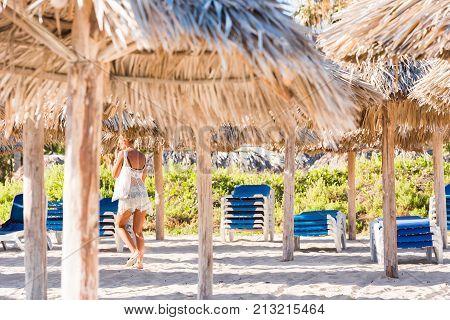 Woman On A Sandy Beach In Varadero, Matanzas, Cuba. Close-up.