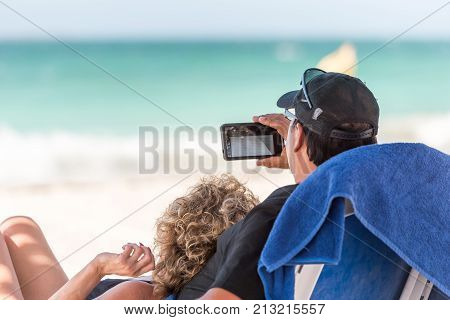 A Married Couple On The Background Of The Sea, Varadero, Matanzas, Cuba. Close-up.