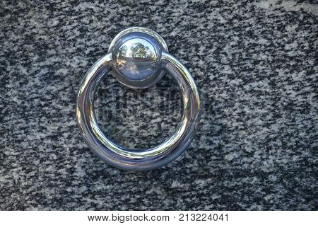 Metal Ring On Grave Of Cemetery. Rusty Iron Handle On Granite Tomb Cover. An 19Th Century Antique Ce