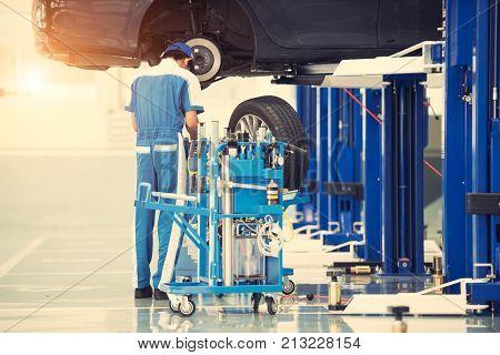 Auto mechanic working at auto repair shop