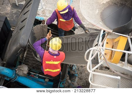 Construction worker Concrete pouring during commercial concreting floors of building in construction site
