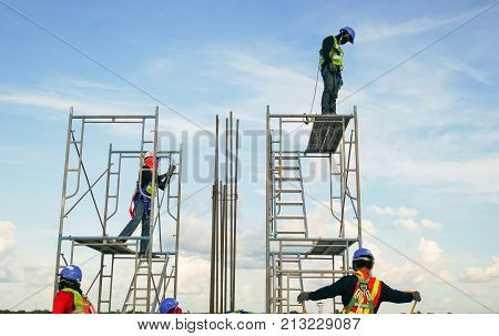 construction worker on scaffolding in industrial construction