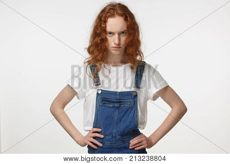 Indoor Closeup Of Young Beautiful Redhead European Lady Isolated On White Background Pressing Her Ha