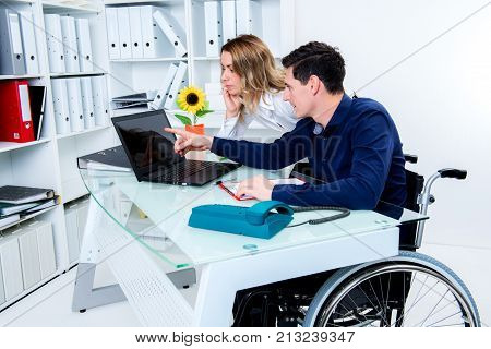 Disabled Business Man Greeting His Female Colleague