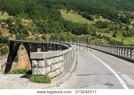ZABLJAKA, MONTENEGRO - SEPTEMBER 11, 2013: The Djurdjevic Bridge is a concrete arch bridge across the Tara River which is 116 meters high.