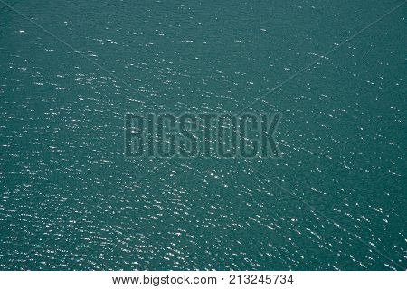 Full frame background of the turquoise-green Pacific Ocean waters off the coast of Noumea, New Caledonia