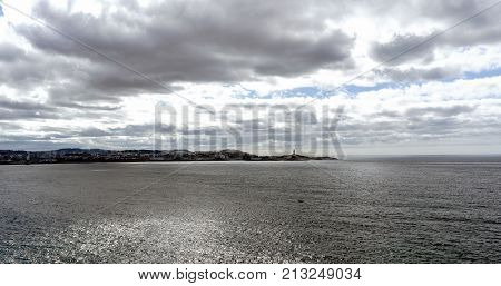 Panoramic View Of The Atlantic Ocean On The Coast Of Spain. In The Background The City Of La Coruna.