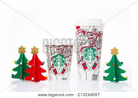 Chiang Mai Thailand- 11 November 2017 - 2 sizes Grande and Venti of Starbucks Coffee paper cups in beautiful 2017 Christmas design display on white background in Chiang Mai Thailand on November 11 2017