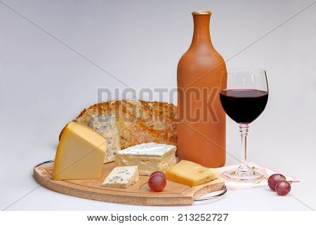Wine, cheese, bread and bottle still life