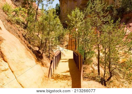 A bridge in the ocher path of Roussillon park in Provence