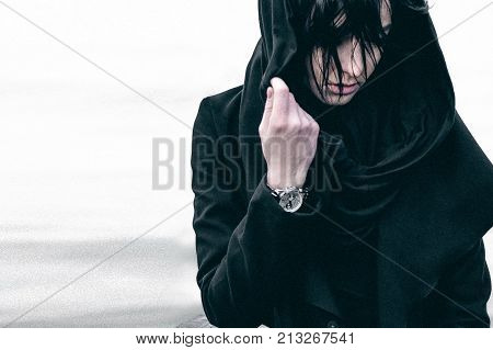 Emotional Fashionable Portrait Of A Young Brunette Woman In Black Clothes, Jeans T-shirt, Coat And S