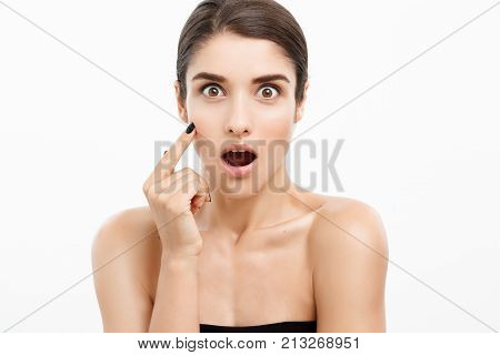 Beauty Skin Care Concept - Beautiful Caucasian Woman Face Portrait Touching Her Chin With Finger Sho