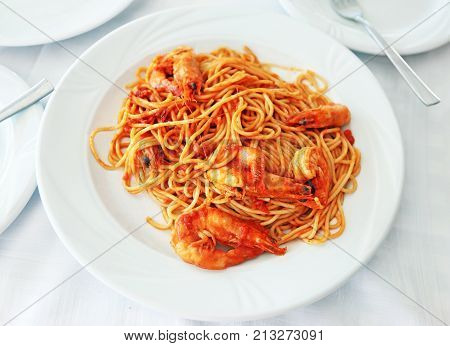 spaghetti with shrimps at a greek tavern - mediterranean seafood