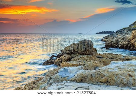 Rocky coastline with magical sunset, Rovinj, Istria peninsula, Croatia, Europe