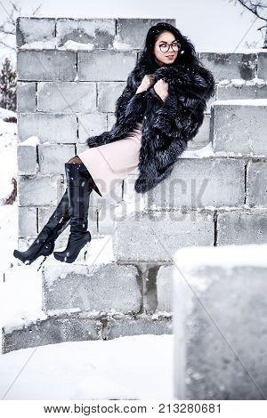 Woman Sitting On A Brick Wall