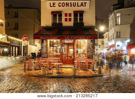 PARIS , France- November 11, 2017: View of typical paris cafe in Paris. Montmartre area is among most popular destinations in Paris, Le Consulat is a typical cafe.